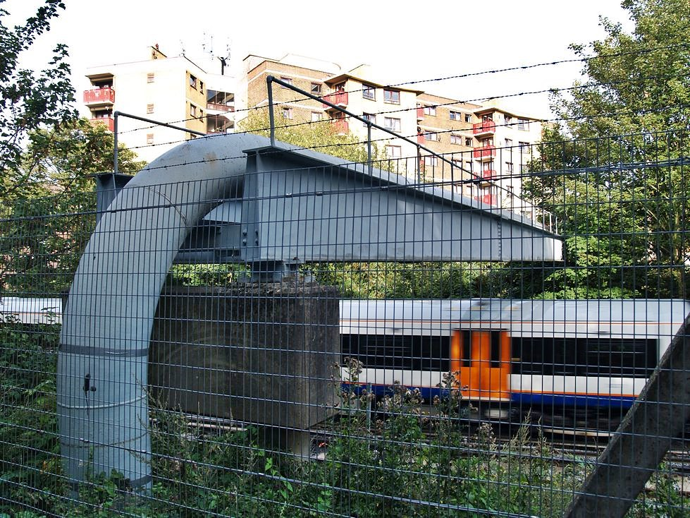 Earl's Sluice - A pipe carries the Earl Sewer over the railway line near Rotherhithe New Road