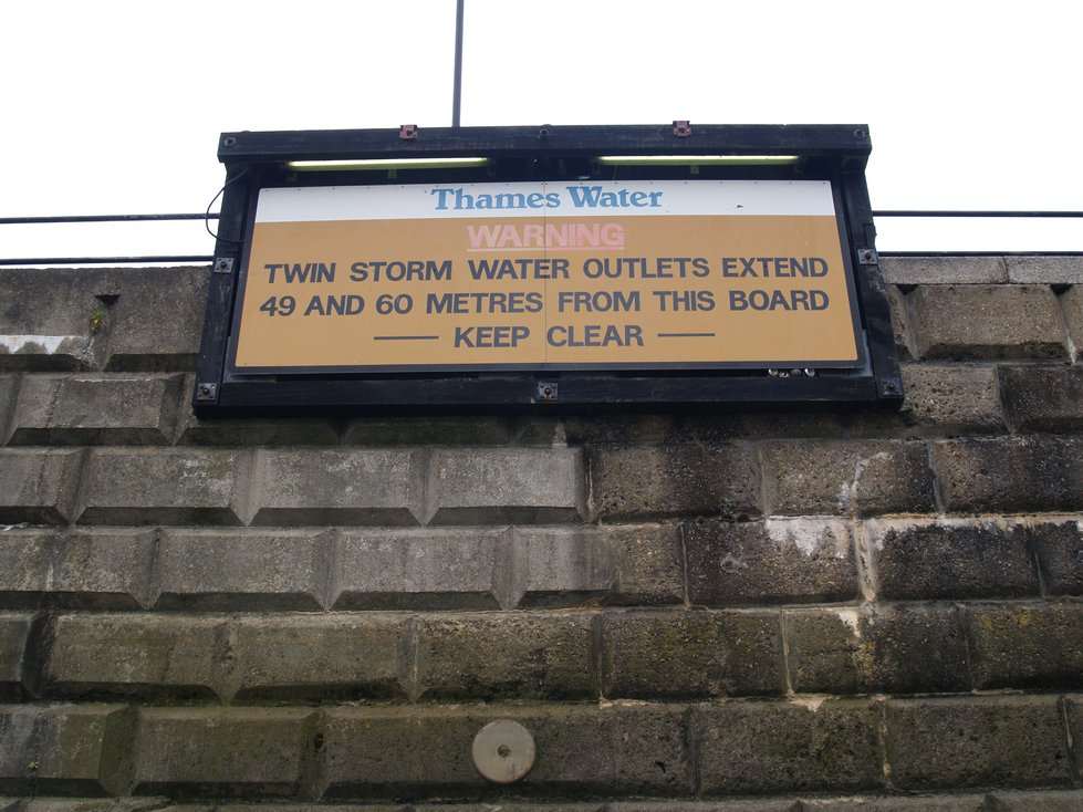 Parr's Ditch. Warnings along the Thames in Hammersmith of  sewer outfalls