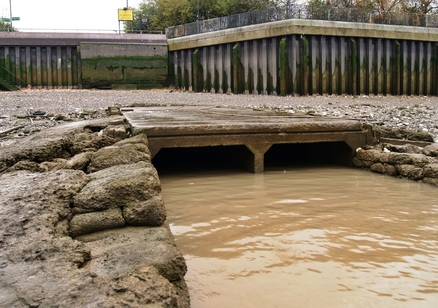 Earls Sluice - sewage outlet visible on the Thames foreshore at St Georges Stairs on the Thames at Rotherhithe.