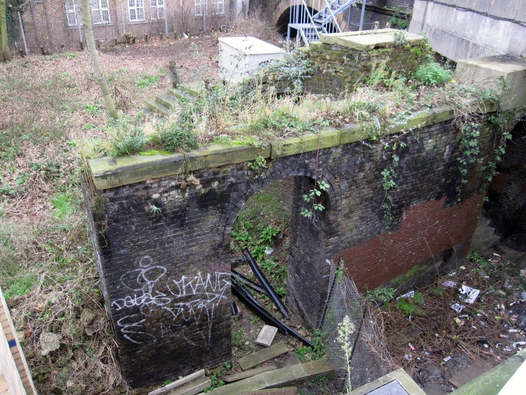 Derelict remains of a lost London canal - the original Kensington Canal bridge at West Brompton Station station