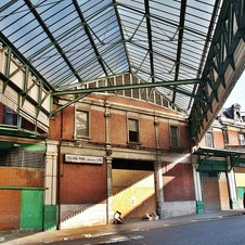 Lost Smithfield and its derelcit market buildings. London walking tours with Paul Talling routes of lost rivers/canals/docks